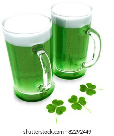 Two green beer's with clovers for St Patrick's day isolated on a white background