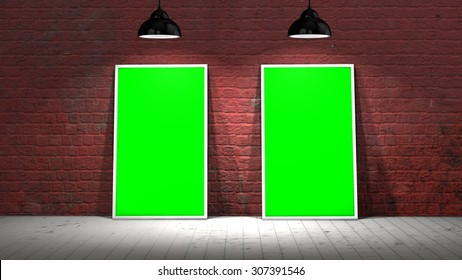 two green screen frames on old brick wall and wooden floor illuminated with spotlights
