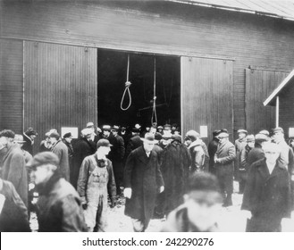 Two hangman's nooses hang as a grim warning to prospective bidders on this foreclosed farm. Farmers conspired to offer low bids at foreclosure auctions and warned others not to raise bids. May 1936.