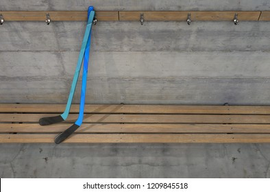 Two ice hocket sticks on a wooden bench in a rundown sports locker change room - 3D render
