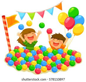 two kids playing in a ball pit with a festive atmosphere
