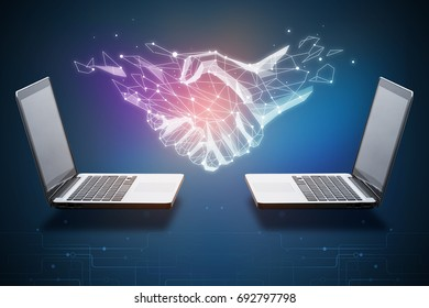 Two laptops with abstract polygonal handshake. Technology, innovation and teamwork concept. 3D Rendering