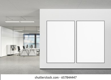 Two large blank vertical posters on the wall in modern office with clipping path around poster. 3d illustration