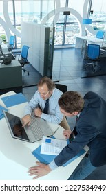Two male executives working in a corporate office 3D rendering