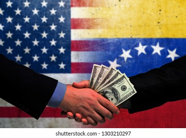 Two men/politicians in suits holding money/US Dollars and shaking hands with the national flag on the background - United States of America and Venezuela