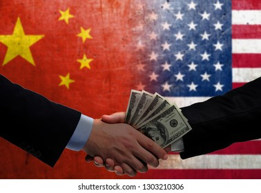 Two men/politicians in suits holding money/US Dollars and shaking hands with the national flag on the background - China and United States of America