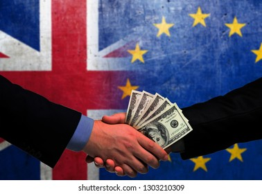 Two men/politicians in suits holding money/US Dollars and shaking hands with the national flag on the background - United Kingdom and European Union