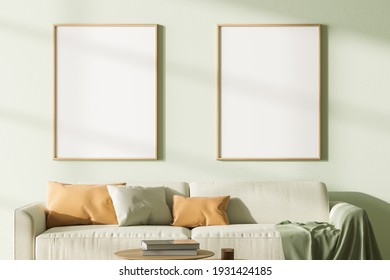 Two mock up posters frame in modern interior background, living room with sofa. 3D rendering