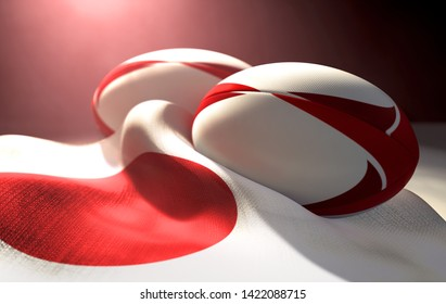 Two regular rugby balls with color design elements resting on a draped japan flag on an isolated dark studio background - 3D render
