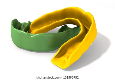 Two regular yellow and green molded sports gum guards on an isolated background