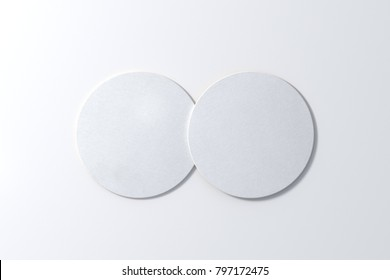 Two round white coasters on white background. 3d illustration
