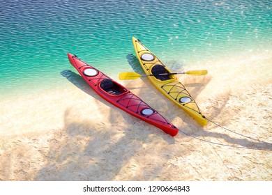 Two sea kayaks on the sand coast. 3D illustration