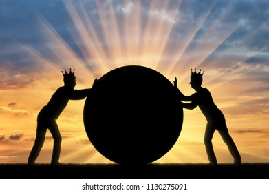 Two selfish men with crowns on their heads, push the big ball without yielding to each other. Conceptual scene of selfish people