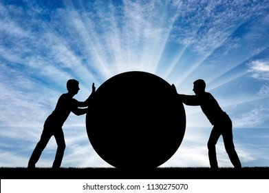 Two selfish men push the big ball, each in its own way, not yielding to each other. Conceptual scene of selfish people