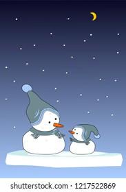 Two snowmen in wintertime