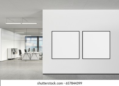 Two square blank posters on the wall in modern office with clipping path around poster. 3d illustration