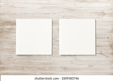 Two Square Magazines with blank soft cover on wooden desk. 3d Illustration for your presentations.