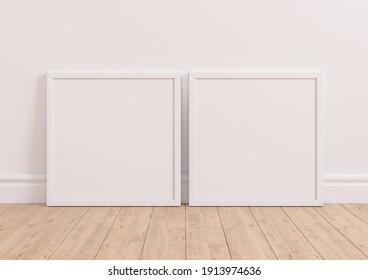 Two square white frame mockup on white clean background on wooden floor. White frame poster on a white wallpaper. 3D Illustration.
