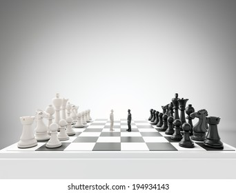 Two tiny figures standing on a chess board - conflict and competition concept illustration