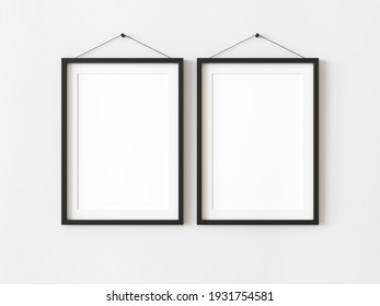 Two vertical blank picture frame for photographs. Isolated black picture frame mockup template on white background. 3D illustration