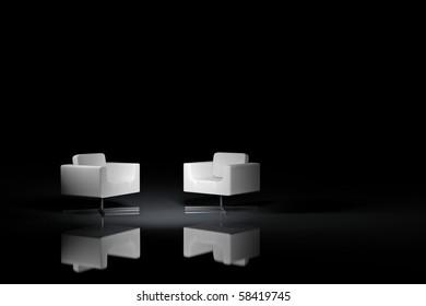 Zwei weiße Sessel auf schwarzem Hintergrund