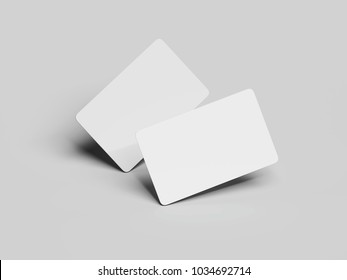 Two white business cards with round corners isolated on gray background. 3d rendering
