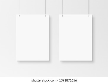 Two White poster isolated hanging by strings on wall mockup 3D rendering