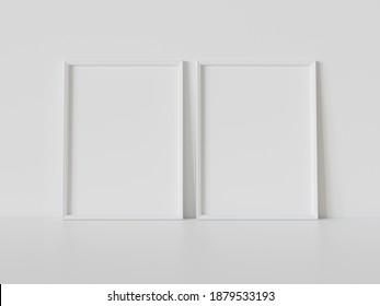 Two white rectangular frames leaning on white floor in interior mockup. Template of pictures framed on a wall 3D rendering