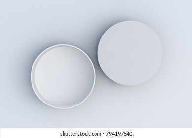 Two white round boxes opened and closed on white background. 3d illustrtion