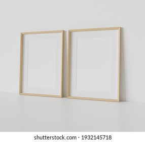 Two wooden rectangular frames leaning on white floor in interior mockup. Template of pictures framed on a wall 3D rendering
