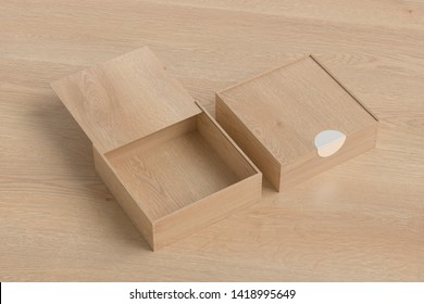 Two wooden square boxes with sliding lid on wooden background. Empty opened and closed box. 3d illustration