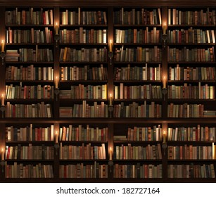Two-storied Bookshelf. Seamless texture (vertically and horizontally). Background. Mysterious library with candle lighting.