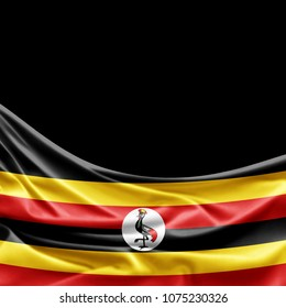Uganda flag of silk with copyspace for your text or images and black background -3D illustration