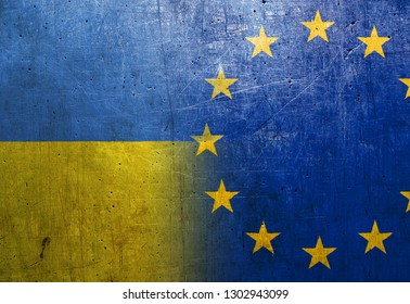 Ukraine and European Union flags on the grunge metal background