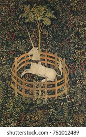 THE UNICORN IN CAPTIVITY, 1495_1505, Netherlandish, Northern Renaissance tapestry. Fertility appears to be the theme of this tapestry. The unicorn rests under a pomegranate tree\xDCa medieval symbol
