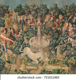 THE UNICORN FOUND, 1495_1505, Netherlandish, Northern Renaissance tapestry. Among plants in a garden, the unicorn and other large mammals and birds, are apparently unaware of the approaching hunters a