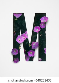 Unique Letter M alphabet made of real blooming flowers and leaves with paper cut. Illustration of floral alphabet collection for design project, poster, card, invitation, brochure and scrapbook