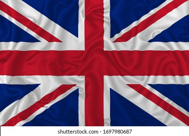United Kingdom country flag on wavy silk textile fabric background.