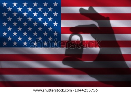 United States of America  closed lock in the hand. Import and export of goods from the world market of trade is prohibited. Closed borders for tourists and immigrants. Epidemic virus