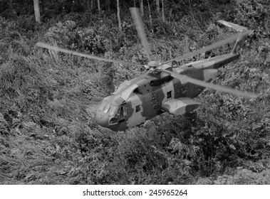 An unmarked US Air Force helicopter landing in Southeast Asian jungle during operation 'Pony Express.' Pony Express provided covert transport for indigenous soldiers. June 1968.