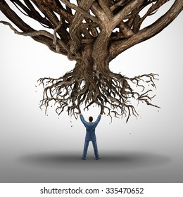 Uprooting and power concept and growth management symbol as a businessman holding up an uprooted tree as an icon for environmental damage as a business idea.