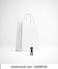 upset man looking at huge blank shopping bag