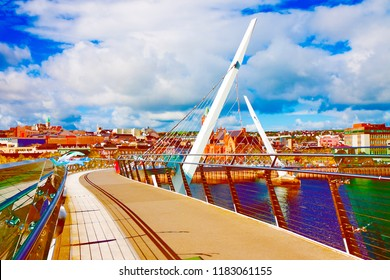 """Urban skyline of Derry city (also called Londonderry) in northern Ireland with the famous """"Peace Bridge"""" (Europe - Northern Ireland) - Art Toned image"""