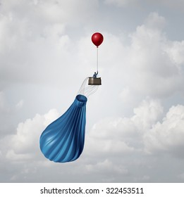 Urgency business plan and crisis management strategy metaphor as a businessman in a broken deflated hot air balloon being saved by a single small balloon as an innovative response solution idea.