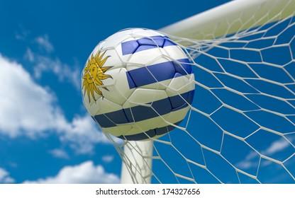 Uruguay flag and soccer ball, football in goal net
