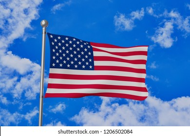 The U.S. national flag (The Stars and Stripes) waving isolated in the blue cloudy sky realistic 3d illustration