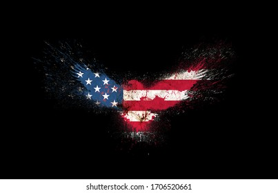 Usa grunge flag in the form of a silhouette of a flying eagle with spread wings with paint splatters isolated on a black background. American flag in a form of a silhouette of a flying eagle.