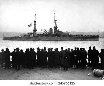 The USS Arizona passing 96th St. Pier in great naval review at New York City. Ca. 1918.