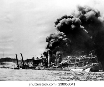 The USS Shaw afire after a direct hit by a Japanese bomber, Pearl Harbor, December, 7, 1941.