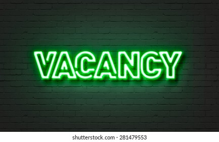 Vacancy neon sign on brick wall background